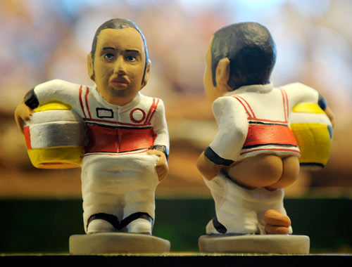 A ceramic figurine called 'caganer' of Lewis Hamilton on show at the Santa Llucia Fair