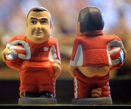 A ceramic figurine called 'caganer' of Fernando Alonso on show at the Santa Llucia Fair