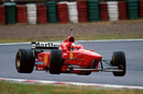 Michael Schumacher slides his Ferrari