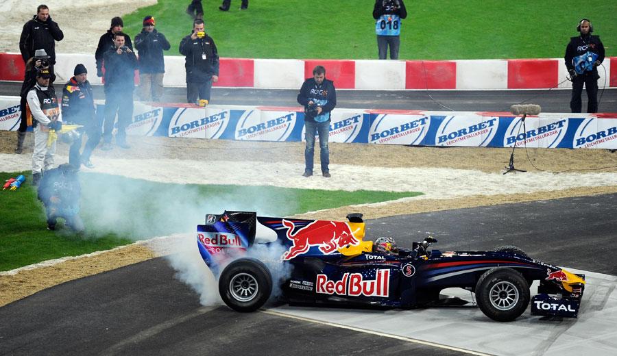 Sebastian Vettel performs stunts in his RB6