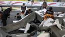 Heikki Kovalainen broke his rear suspension after crashing heavily