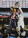 Sebastian Vettel and Michael Schumacher celebrate winning the Nations Cup at the Race of Champions