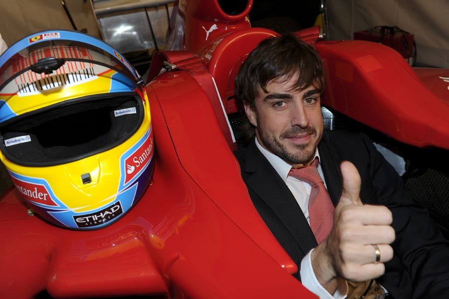 Fernando Alonso gives the thumbs up at the 2010 Ferrari World Finals