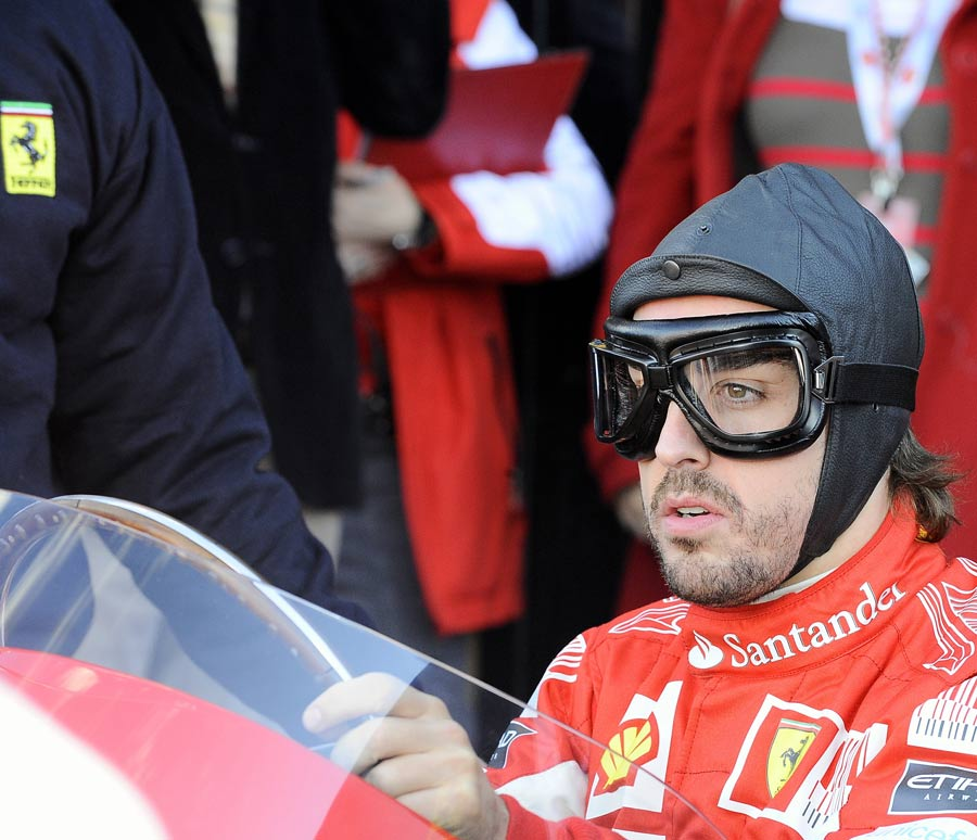 Fernando Alonso in the cockpit of a vintage Ferrari at the 2010 Ferrari World Finals