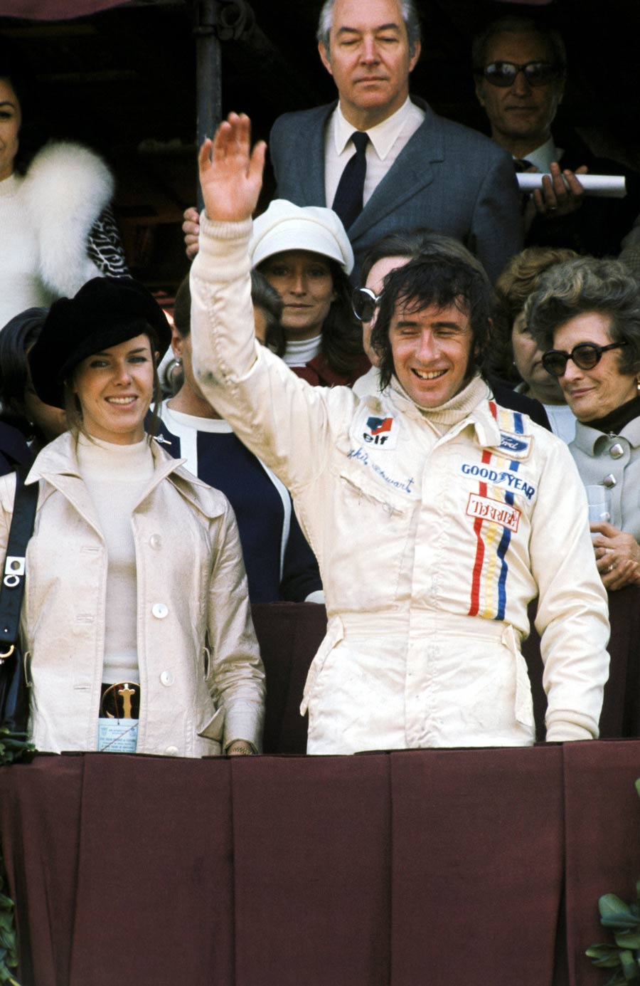 Jackie Stewart celebrates winning the Spanish Grand Prix on the podum with wife Helen