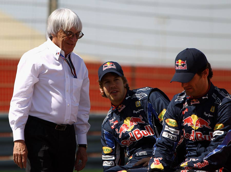 Bernie Ecclestone talks to Sebastian Vettel and Mark Webber