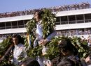 Jackie Stewart celebrates victory on the podium with Tyrrell team-mate Francois Cevert and Emerson Fittipaldi