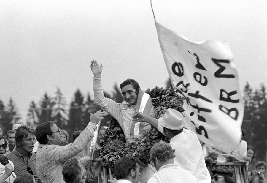Jo Siffert celebrates winning the Austrian GP
