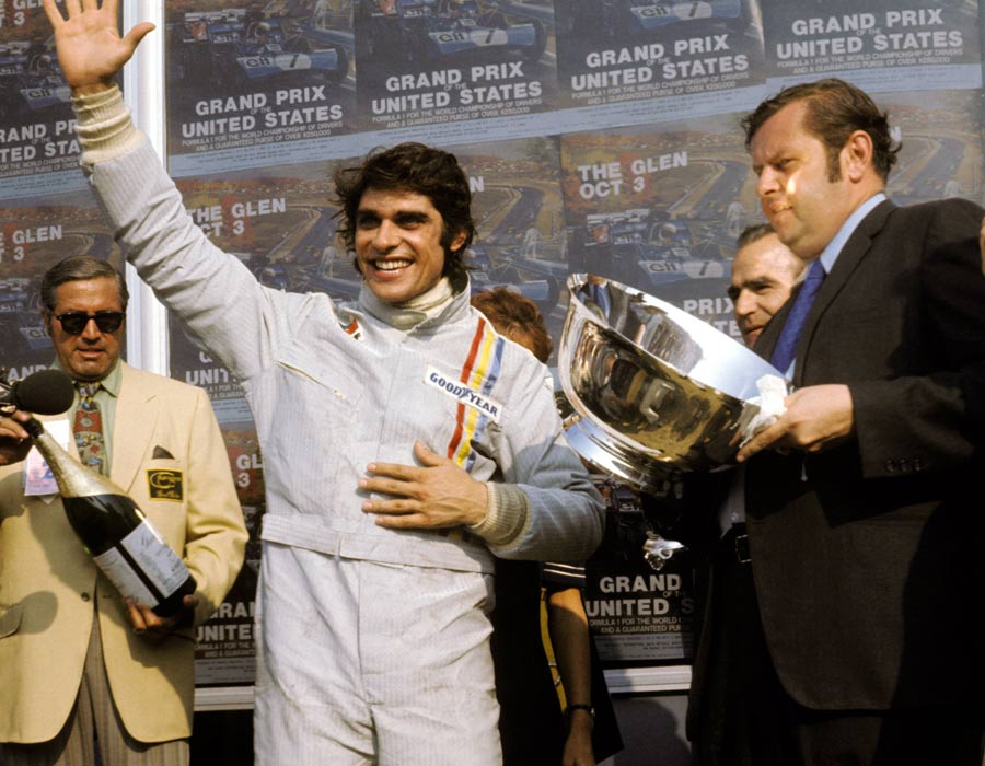 A jubilant Francois Cevert celebrates his first GP victory after the final round of the season