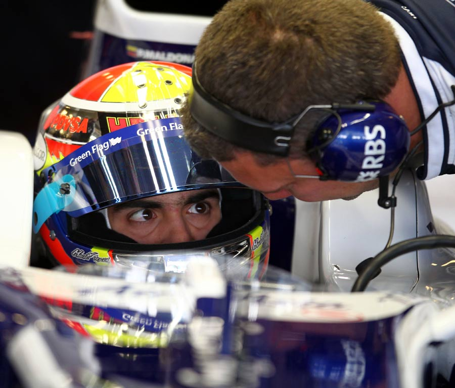 Pastor Maldonado listens to advice in the Williams cockpit