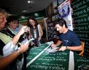 Mark Webber signs copies of his new book in Melbourne