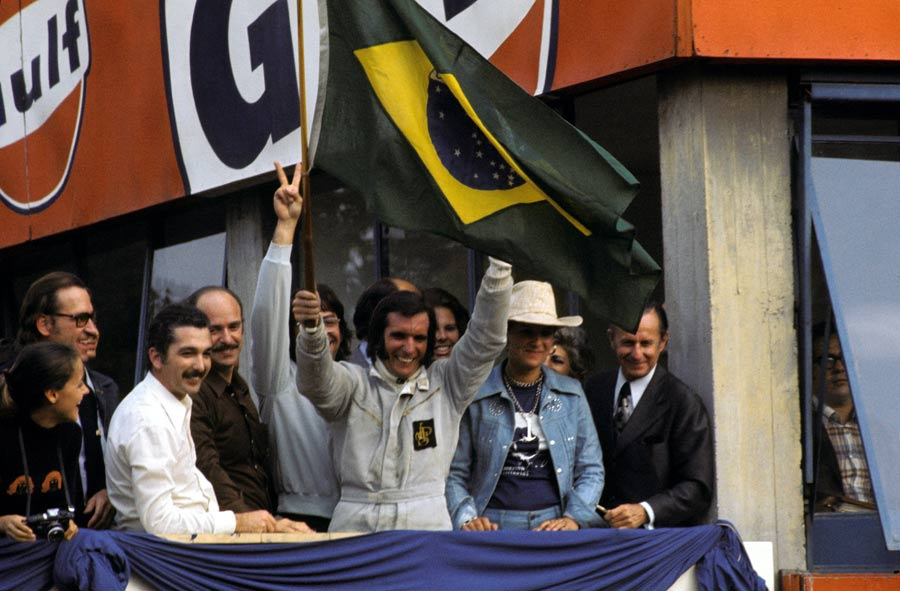 Emerson Fittipaldi celebrates winning the Italian Grand Prix and becoming world champion