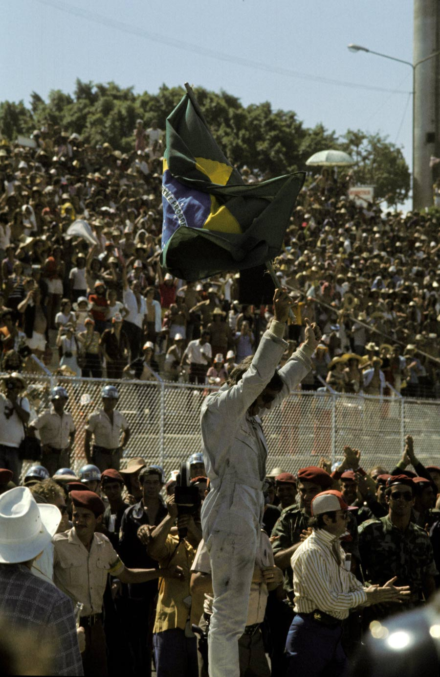 Emerson Fittipaldi celebrates victory on home soil