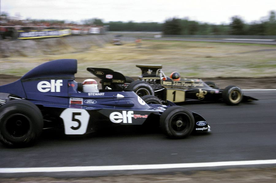 Jackie Stewart pressures Emerson Fittipaldi
