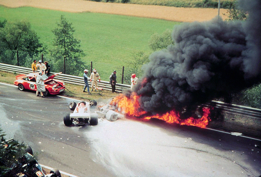 Niki Lauda's Ferrari spews flames after his crash at the Nurburgring