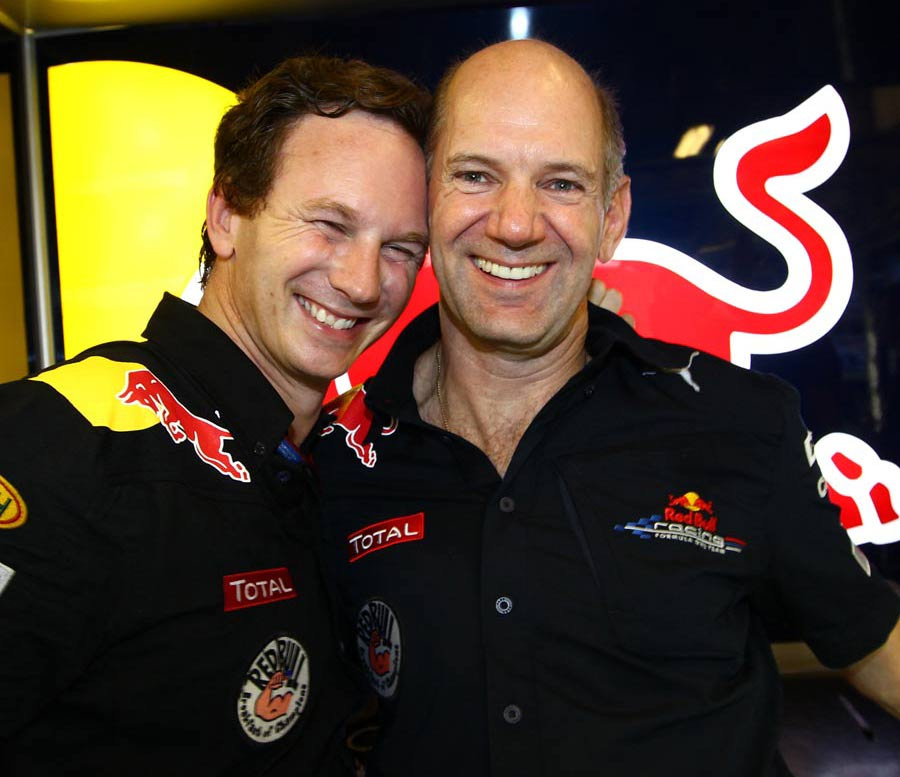 Christian Horner celebrates his team's historic double with Adrian Newey