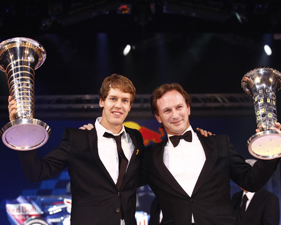 Sebastian Vettel and Christian Horner celebrate Red Bull's success