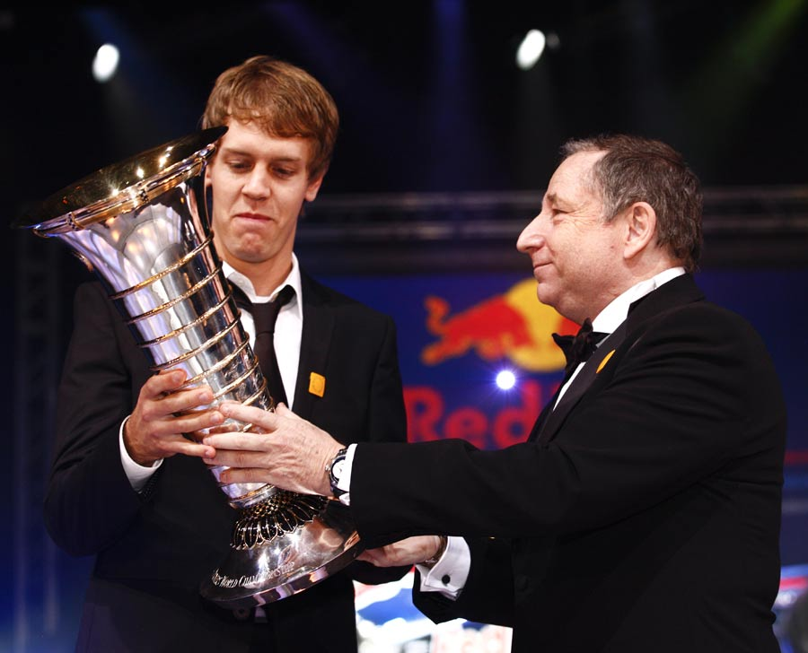 Jean Todt presents Sebastian Vettel with the drivers' trophy