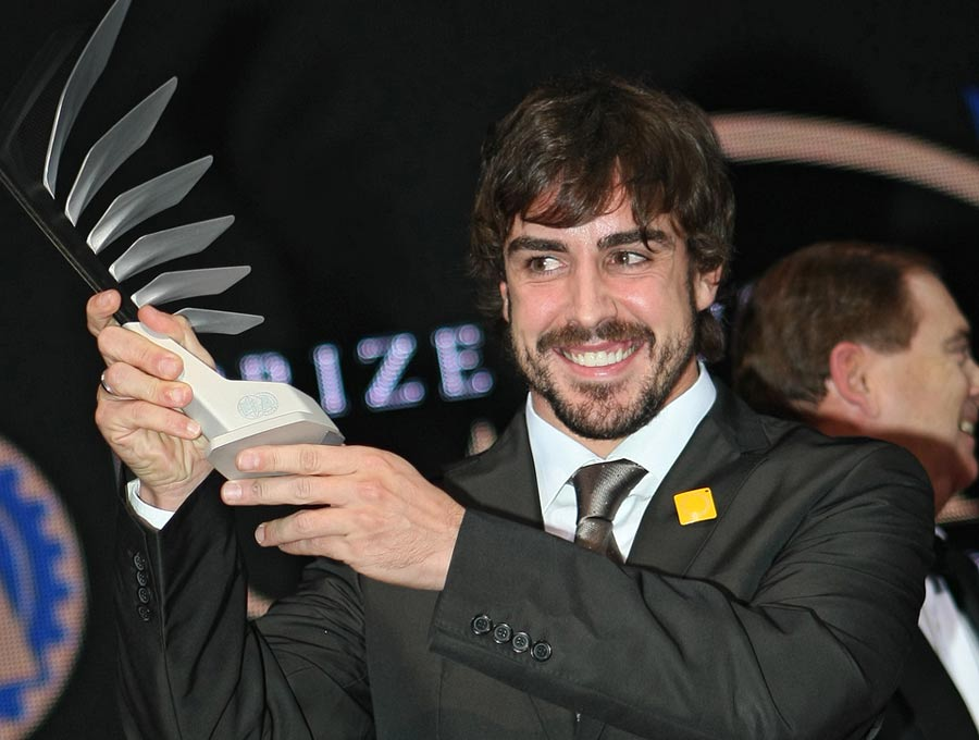 Fernando Alonso holds his trophy for finishing second in the drivers' championship