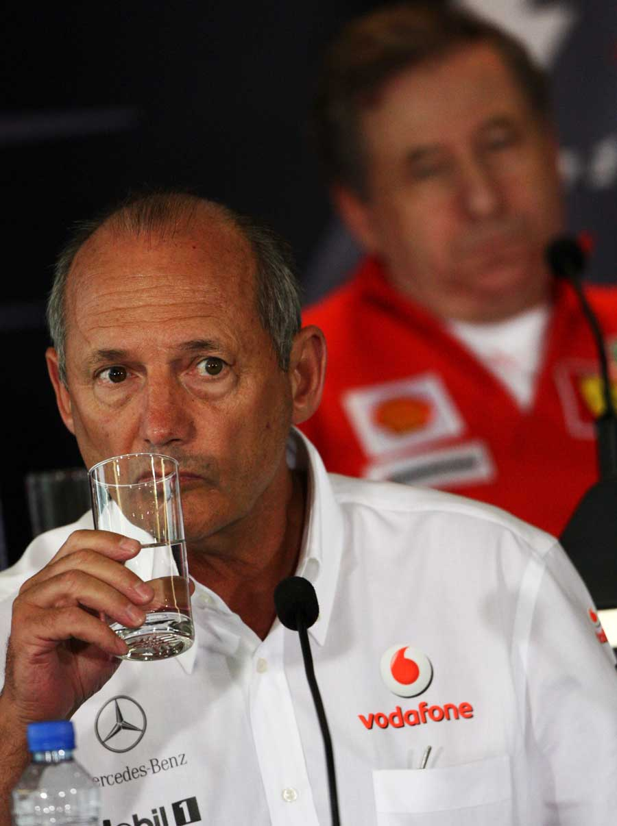 Ron Dennis and Jean Todt face questions in a press conference
