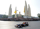 Mark Webber takes his Red Bull past the Democracy Monument