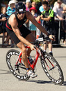 Jenson Button mounts his bike during the City of Rockingham Triathlon