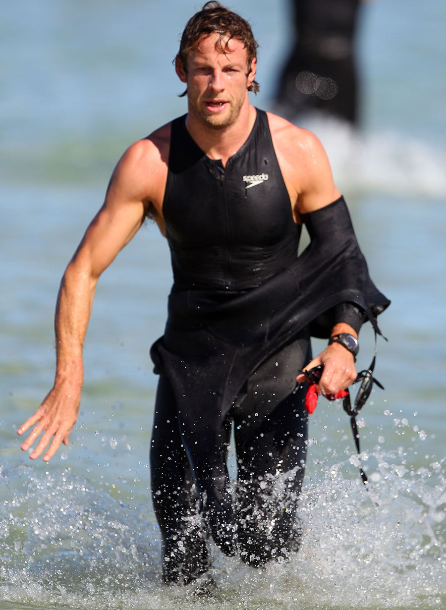 Jenson Button finishes the swimming leg of his triathlon