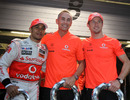 Lewis Hamilton, Martin Whitmarsh and Jenson Button pose for a photo after McLaren took a 1-2 victory