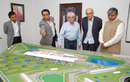 Bernie Ecclestone, with Indian Grand Prix representatives, look at the Jaypee International Race Circuit model