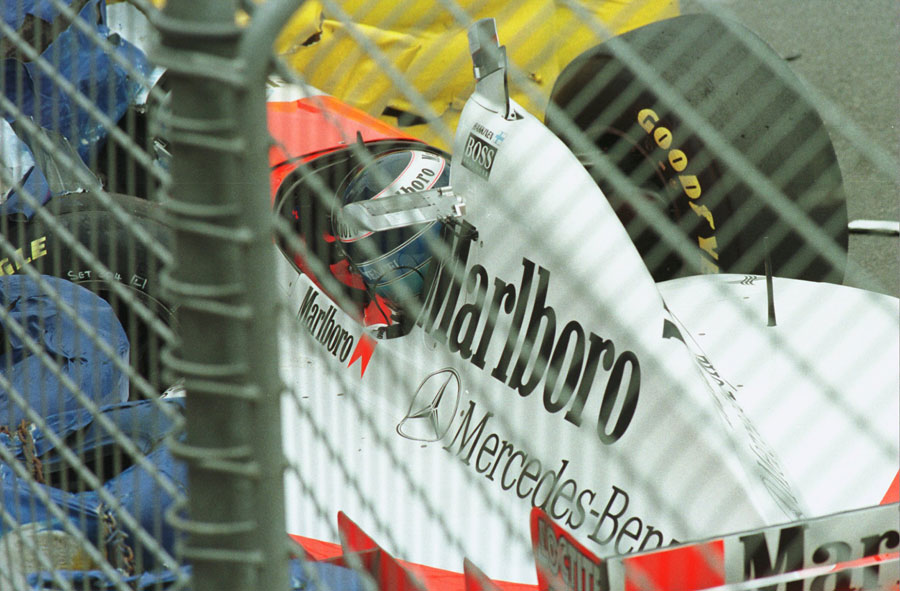 Mika Hakkinen lies unconcious in his McLaren after a near-fatal accident during qualifying for the Australian Grand Prix