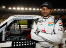 Narain Karthikeyan poses for a photo on the grid