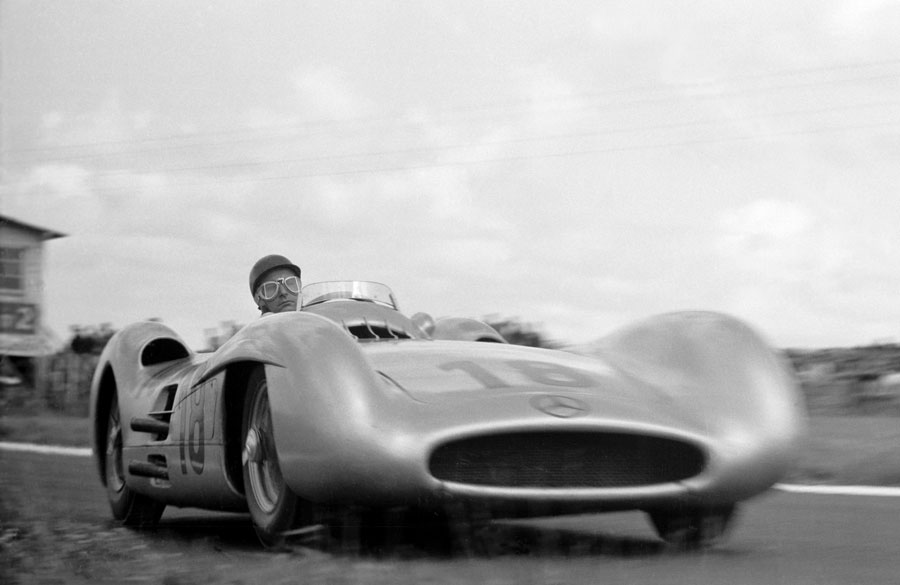 Juan Manuel Fangio guides the sleek Mercedes W196 towards the apex