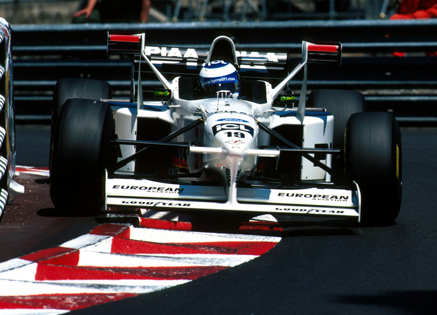 Mika Salo rides the kerbs in the distinctive Tyrrell 025 (X-Wing)