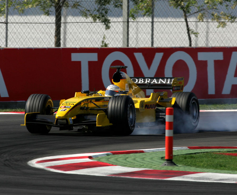 Narain Karthikeyan locks up under braking in the Jordan