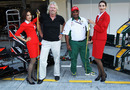 Sir Richard Branson and Tony Fernandes are measured for stewardess outfits in the pit lane