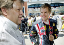 Norbert Haug gives Sebastian Vettel a few words of advice on the grid