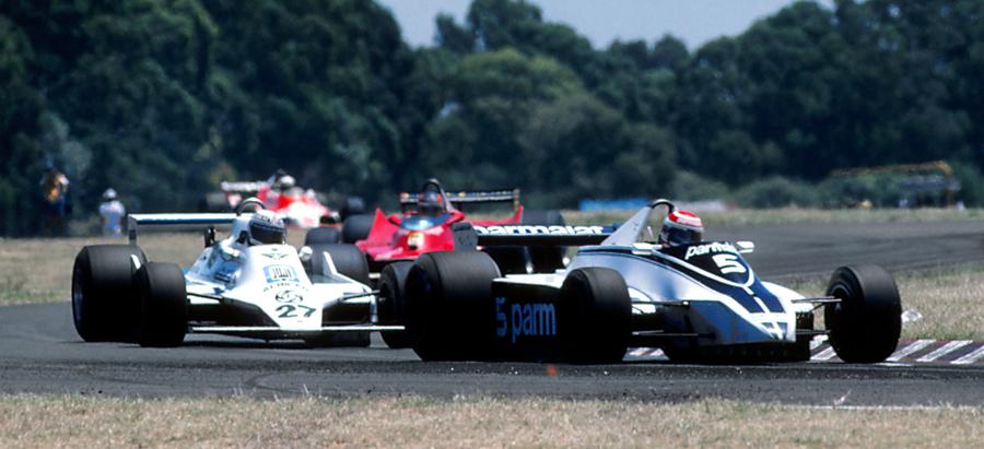 Nelson Piquet leads eventual race winner Alan Jones
