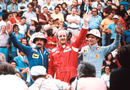 Denny Hulme, flanked by Clay Regazzoni and Niki Lauda, takes the plaudits