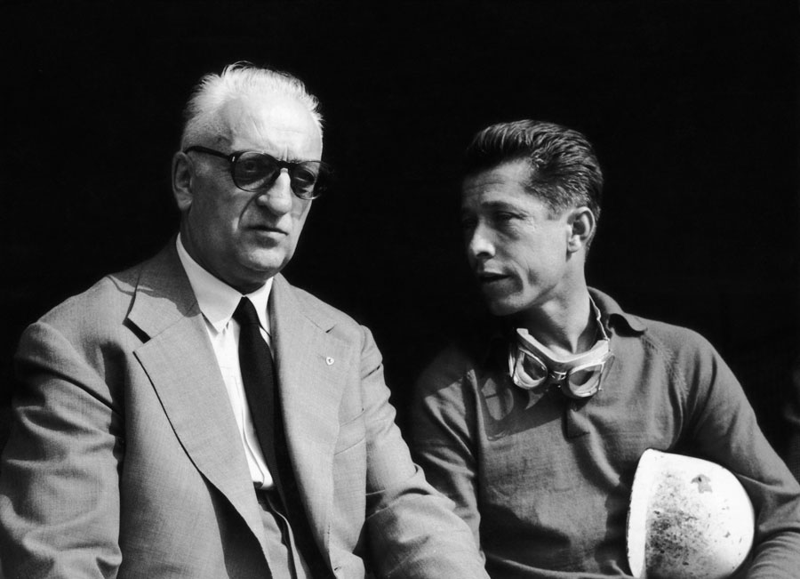 Enzo Ferrari chats with Belgian driver Olivier Gendebien ahead of practice