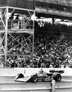 AJ Foyt raises his hand in victory as he crosses the finish line