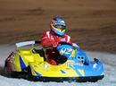 Fernando Alonso takes part in an ice-karting race