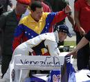 Pastor Maldonado and Venezuela president Hugo Chavez inspect a Williams F1 car