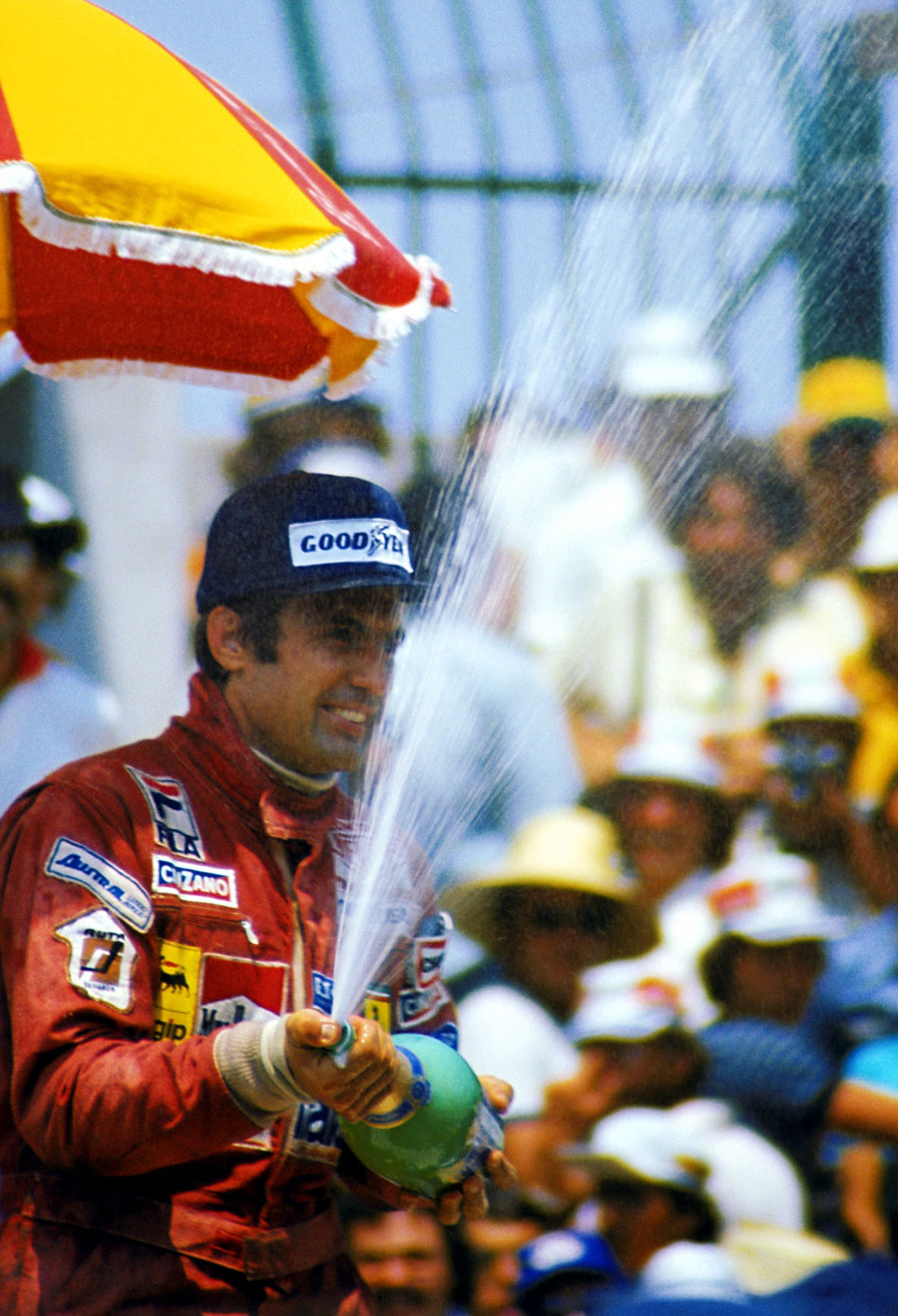 Carlos Reutemann  celebrates his victory on the podium
