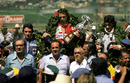 Patrick Depailler, race winner  Niki Lauda and Tom Pryce take the post-race plaudits