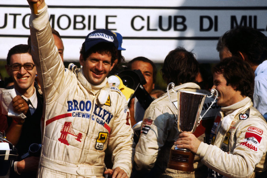 Jody Scheckter celebrates on the podium with second placed team-mate Gilles Villeneuve