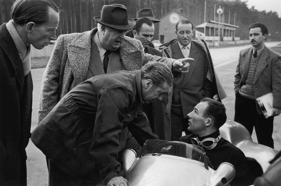 Alfred Neubauer gives orders to his new driver Stirling Moss during a test at Hockenheim