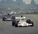 Peter Revson on trackk in the McLaren ahead of Emerson Fittipaldi