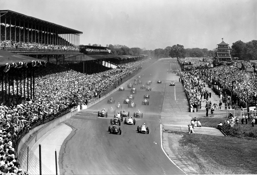 Thirty-three competitors in the Indianapolis 500-mile race approach the first curve