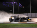 Pedro de la Rosa's Toyota TF109 throws up spray during testing