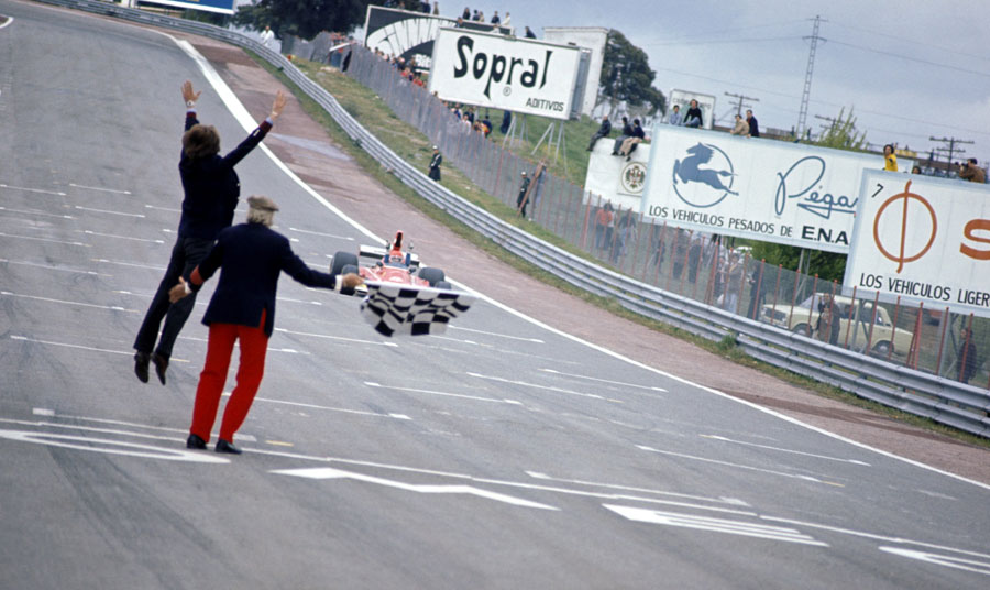 Luca di Montezemolo jumps for joy as Niki Lauda crosses the line for victory